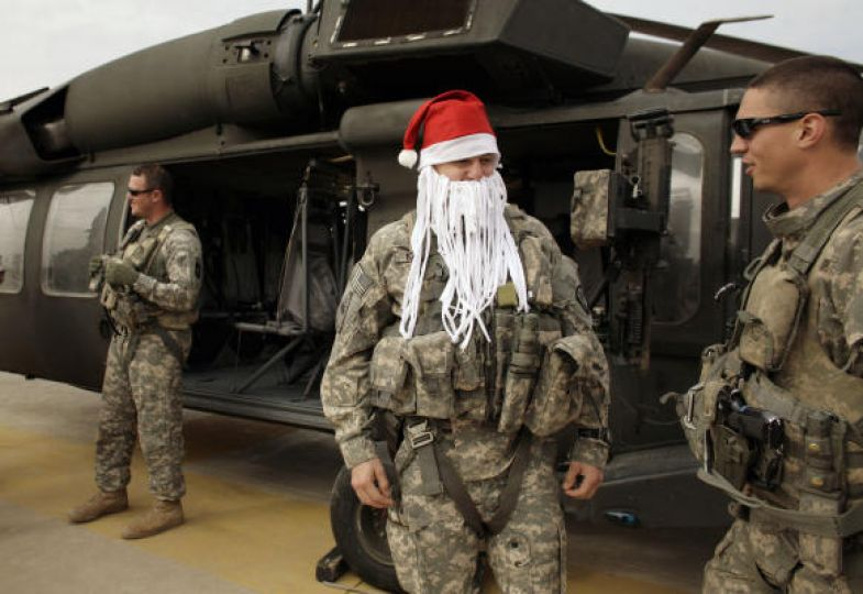 U.S. Army Chief Warrant Officer Derrick Nunley, 27, from Desoto, Kan., returns after flying in a Blackhawk helicopter on Christmas Day at Camp Victory near Baghdad. via AP/Houston Chronicle,