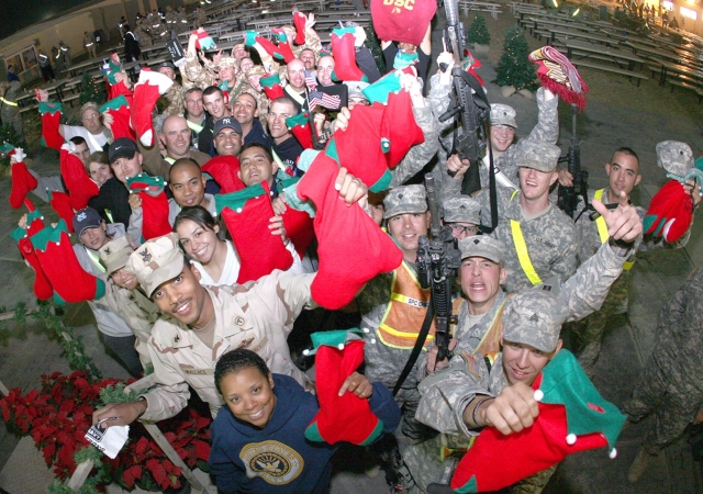 Servicemembers at Camp Buehring, Kuwait, celebrate the holidays. via Army.mil, 2007
