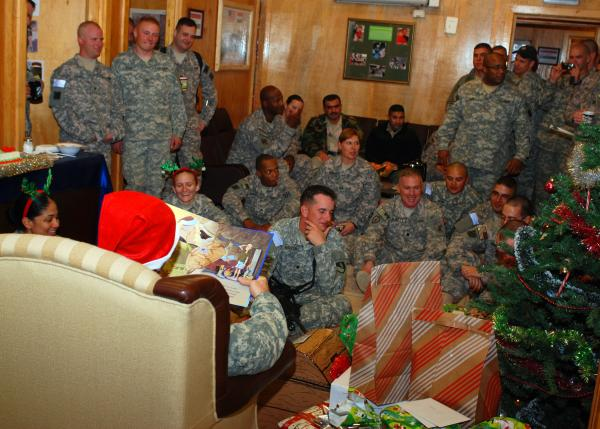 """Soldiers of Command Post-North, Task Force Marne, listen as Brig. Gen. Tom Vandal, reads the book """"The Soldiers' Night Before Christmas"""" on Christmas Eve. Photo provided by U.S. Army photo by Spc. Daniel Nelson, 145th Mobile Public Affairs Detachment, 3rd Infantry Division"""