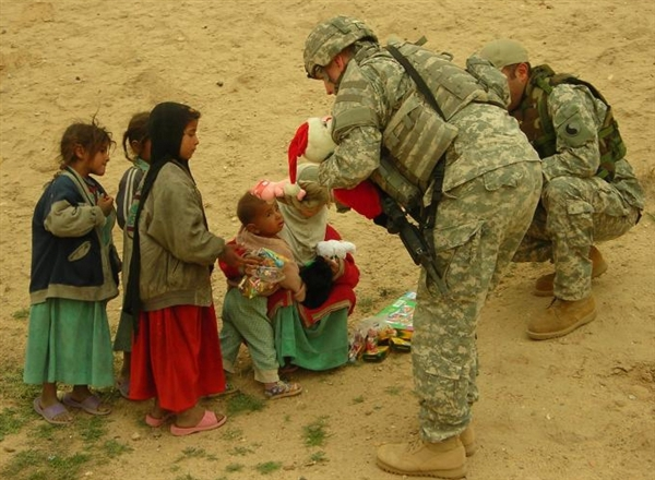 Deployed troops share their Christmas stockings with children. Operation Give, a troop-support group, sent more than 20,000 stockings to troops in Iraq and Afghanistan as part of its annual Operation Christmas Stocking collection. via American Forces Press Service
